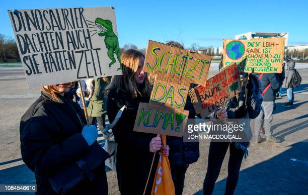 Protesters display placards reading among others Dinosaurs also thought they had time and Protect the Climate in front of Germany's Bundestag lower...