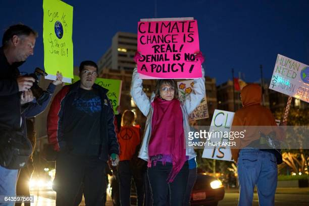 Protesters display signs in support of the environment during a rally against climate change in San Diego California on February 21 2017 The US...