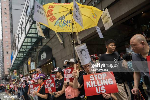 Protesters displaying placards which reads Stop killing us during the demonstration Despite the Chief Executive Carrie Lam's attempt to ease the...