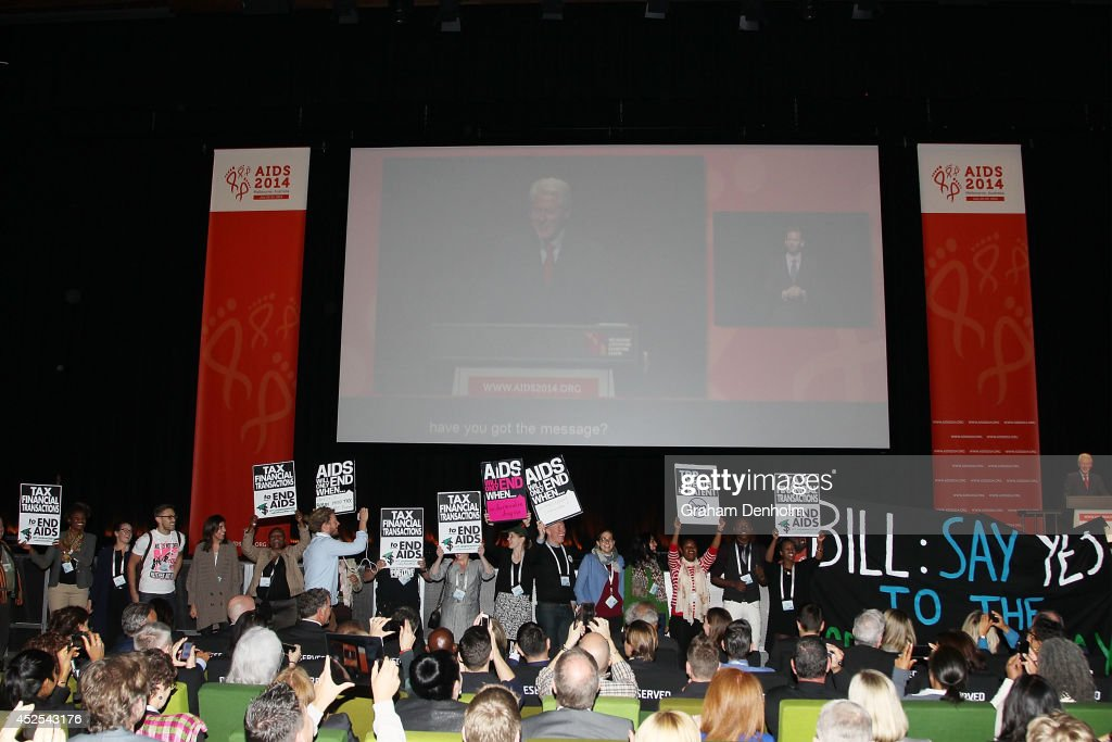 Protesters disrupt former U.S. President Bill Clinton as he addresses the 20th International AIDS Conference at The Melbourne Convention and Exhibition Centre on July 23, 2014 in Melbourne, Australia. Several researchers, activists and health workers due to attend the conference were killed enroute in the Malaysian Airlines plane MH17 shot down over Eastern Ukraine.