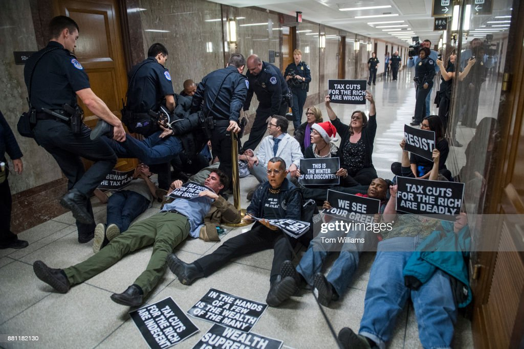 Protesters disrupt the Senate Budget Committee markup of the tax reform bill in Dirksen Building on November 28, 2017.