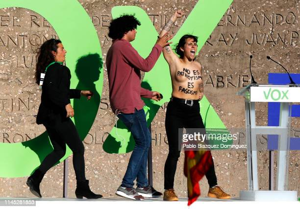 FEMEN protesters disrupt the VOX closing rally on April 26 2019 in Madrid Spain Spaniards go to the polls to elect 350 members of the parliament and...