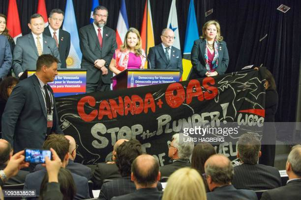 Protesters distrupt the press conference as Canadian Minister of Foreign Affairs Chrystia Freeland speaks during the 10th Lima Group meeting in...