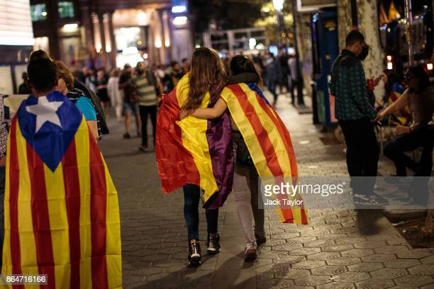 Protesters draped in the Catalan independence flag leave following a demonstration for Catalan independence to demand the release of imprisoned...