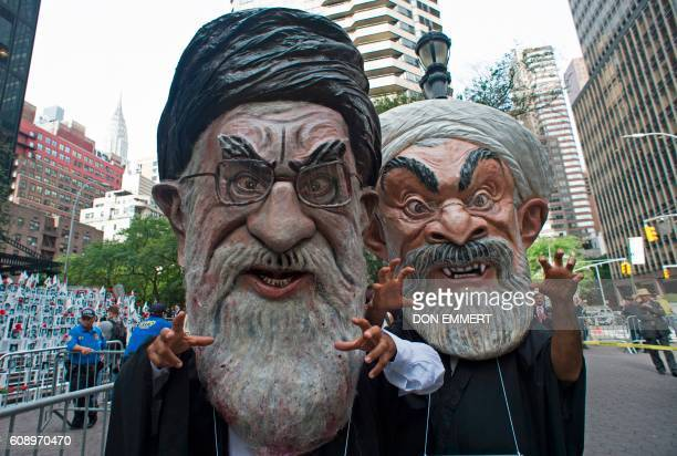 Protesters dressed as Ali Khamenei Iran's Supreme leader and Hassan Rouhani Iran's President join Iranien Americans in support of the National...