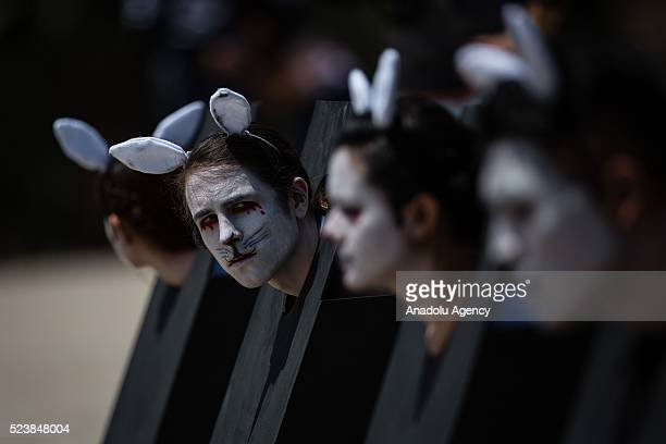 Protesters dressed as an animal are seen during the protest of the proanimal organization AnimaNaturalis against animal testing at the Monumento a la...