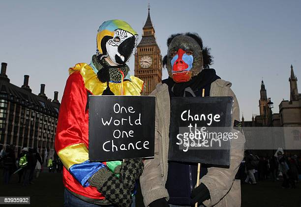 Protesters dressed as endangered animals on the National Climate March 2008 finish their rally in Parliament Square on December 6 in London England...