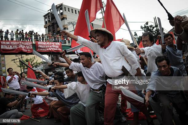 Protesters dressed as Katipuneros hold a demonstration outside the presidential palace in Manila Philippines November 30 2013 Demonstrators marked...