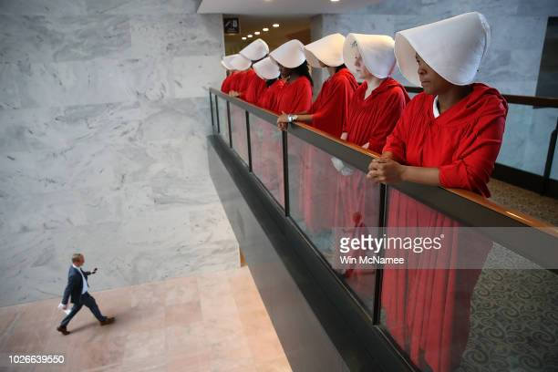 Protesters dressed in The Handmaid's Tale costume protest outside the hearing room where Supreme Court nominee Judge Brett Kavanaugh will testify...