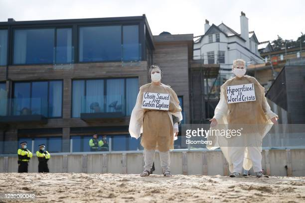 Protesters dressed in white and hessian sacks demonstrate against tree felling at the Carbis Bay Hotel development site on the beach at Carbis Bay,...