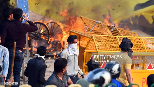 Protesters during violent clashes between anti and pro CAA demonstrations, at Jaffarabad, near Maujpur on February 24, 2020 in New Delhi, India. A...