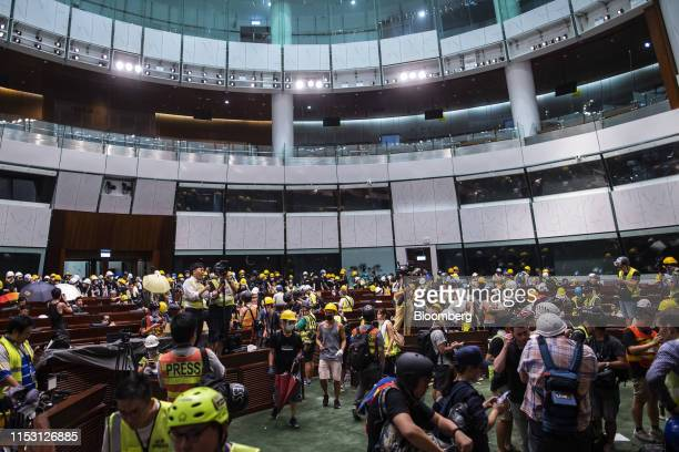Protesters enter the chamber of the Legislative Council building in Hong Kong China on Monday July 1 2019 Protesters flooded into Hong Kongs...