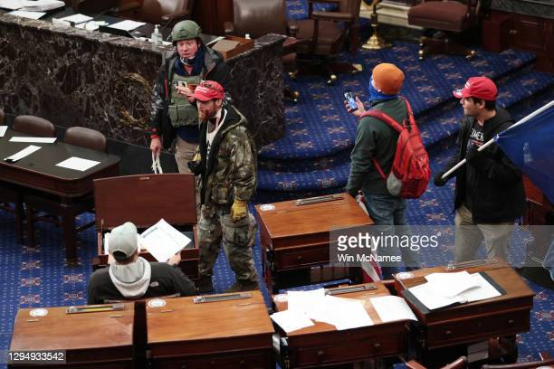 Protesters enter the Senate Chamber on January 06, 2021 in Washington, DC. Congress held a joint session today to ratify President-elect Joe Biden's...
