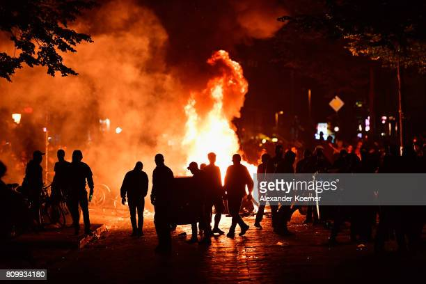 Protesters erect burning barricades in front of the Rote Flora leftwing centre after the Welcome to Hell protest march on July 6 2017 in Hamburg...