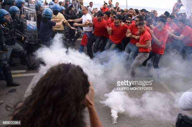 Protesters face antiriot policemen during a rally against the G7 Summit in GiardiniNaxos near the venue of the G7 summit of Heads of State and of...