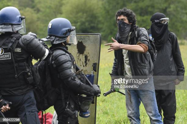 Protesters face French riot gendarmes during a second eviction of environmental protesters from the area known as ZAD at the site of an abandoned...