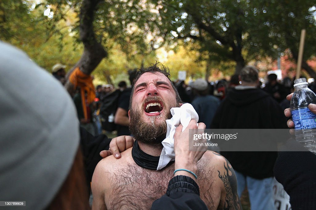 A protester's face is cleaned after he was pepper-sprayed by police at the 'Occupy Denver' camp on October 29, 2011 in Denver, Colorado. Following a march by protesters, police tried to tear down some newly-erected tents at the encampment and and a melee ensued. Police detained about a half dozen people and pepper-sprayed others before calling for reinforcements.