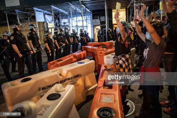 Protesters face off against New York City Police during a march to honor George Floyd near Union Square on May 31 2020 in New York City Protesters...
