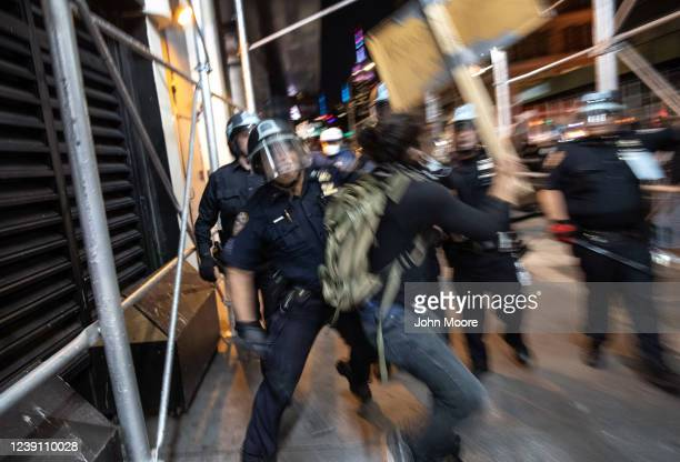 Protesters face off with New York City Police during a march to honor George Floyd near Union Square on May 31, 2020 in New York City. Protesters...