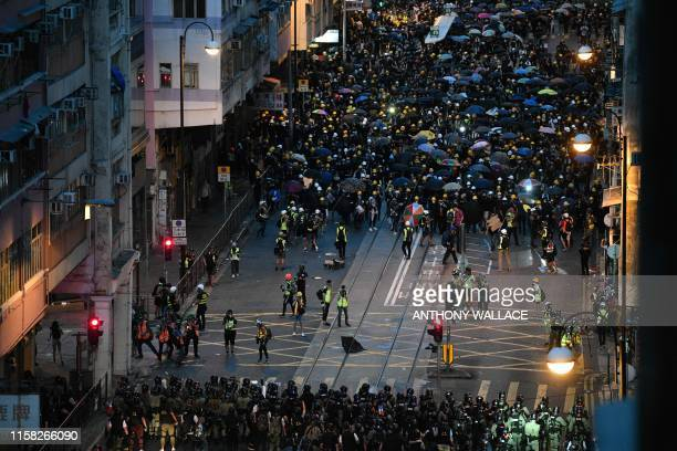 TOPSHOT Protesters face off with police during a demonstration against a controversial extradition bill in Hong Kong on July 28 2019 Tens of...