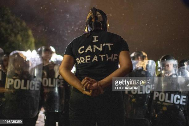 Protesters face off with police outside the White House in Washington, DC, early on May 30, 2020 during a demonstration over the death of George...