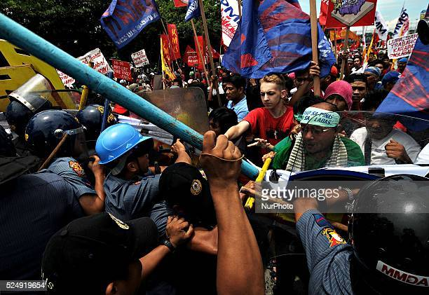 Protesters face off with riot police as they attempt to get closer to the House of Representatives where Philippine President Benigno Aquino III is...