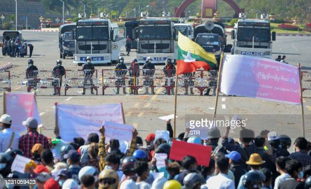 Protesters face off with riot police during a demonstration against the military coup in Naypyidaw on February 9, 2021.