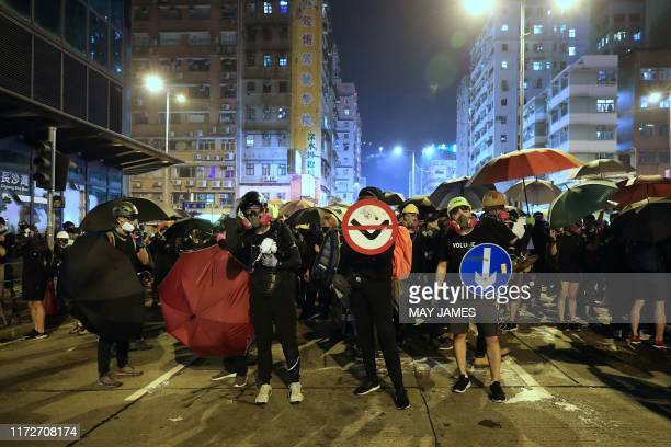 Protesters face off with riot police in the Sham Shui Po district of Hong Kong on October 1 as violent demonstrations take place in the streets of...