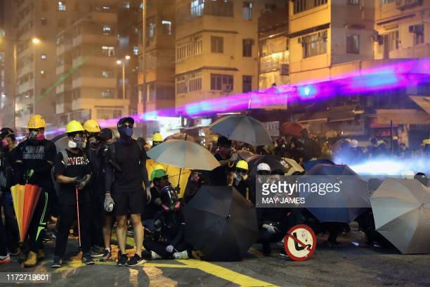 TOPSHOT Protesters face off with riot police in the Sham Shui Po district of Hong Kong on October 1 as violent demonstrations take place in the...