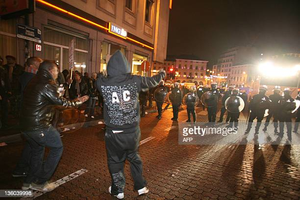 Protesters face police during a demonstration of the local Congolese people in the Matonge district of Brussels on December 17 2011 at the end of a...