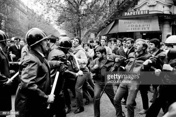 Protesters face police in front of the Joseph Gibert bookstore Boulevard Saint Michel on May 6 1968 in Paris PHOTO / Jacques MARIE