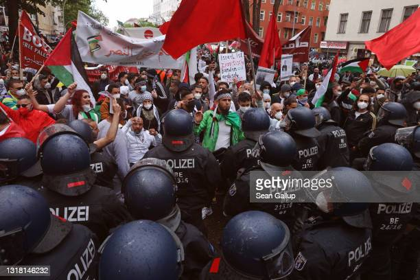 Protesters face riot police as they march on Al Nakba Day to demonstrate for the rights of Palestinians in Neukoelln district on May 15, 2021 in...