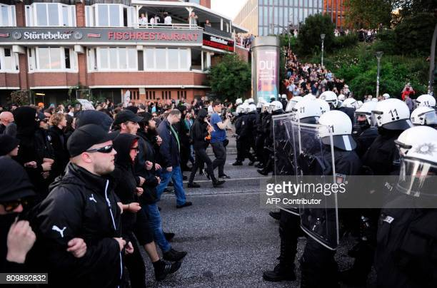 Protesters face riot police during during the 'Welcome to Hell' rally against the G20 summit in Hamburg northern Germany on July 6 2017 Leaders of...