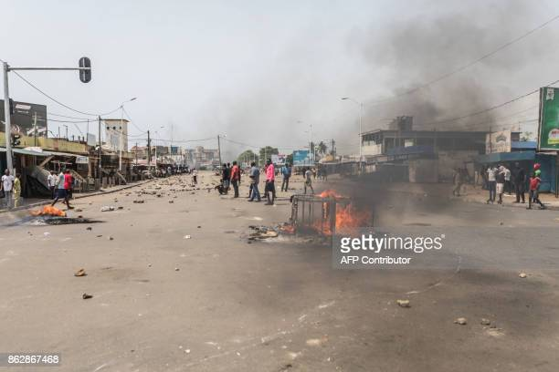 Protesters face security forces during clashes as part of an anti-government protest in Lome on October 18, 2017. Protesters erected makeshift...