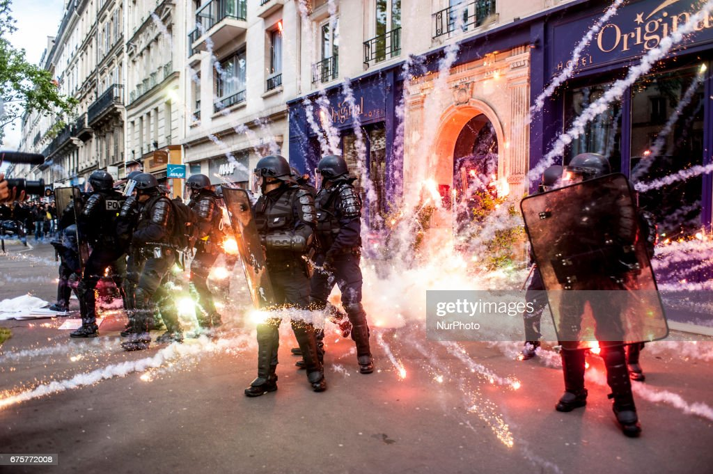 Protesters fail with incendiary bombs and molotov cocktails at the May Day in Paris, France, on May 1st, 2017. Thousands of demonstrators parade for National Labor Day And against Marine Le Pen and Emmanuel Macron, the two candidates in the French presidential elections. Clashes broke out on the sidelines of the May Day demonstrations in the Parisian capital.