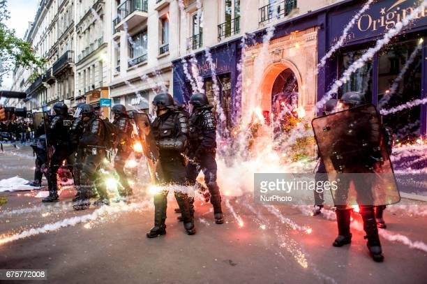 Protesters fail with incendiary bombs and molotov cocktails at the May Day in Paris France on May 1st 2017 Thousands of demonstrators parade for...