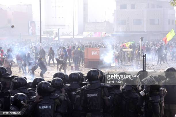 Protesters fights against gendarmes near their barracks in Colobane neighbourhood in Dakar on March 5, 2021 during clashes following the arrest of...