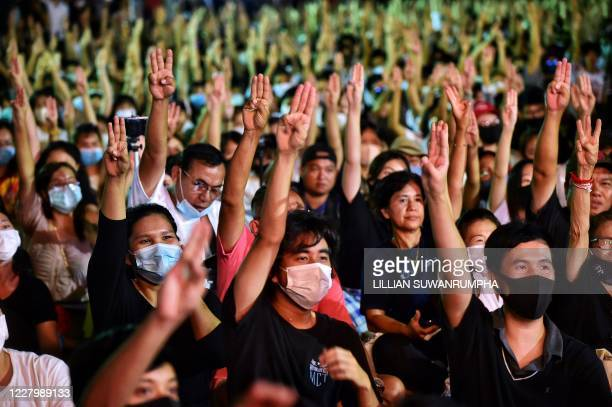 Protesters flash the Hunger Games salute during a pro-democracy rally at Thammasat University in Pathum Thani, north of Bangkok, on August 10, 2020.