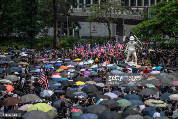 Protesters fly US flags as they gather before marching to the US consulate during a demonstration on September 8 2019 in Hong Kong China Prodemocracy...