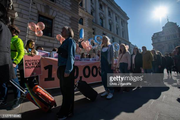 Protesters for a change in Northern Irish law on abortion walk past a counter demonstration at Parliament Square on February 26 2019 in London...
