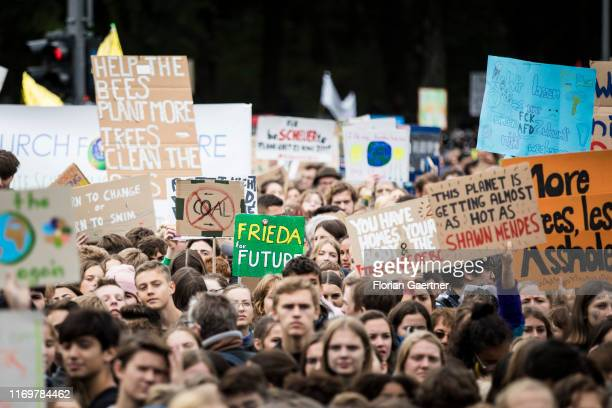 Protesters for climate protection demonstrate within the worldwide movement 'Fridays for Future' near the Brandenburg Gate on September 20, 2019 in...