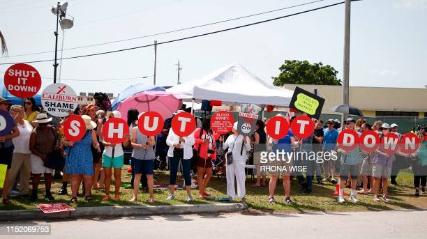 Protesters for the release of migrant children stand in front of a detention center in Homestead Florida on June 26 2019