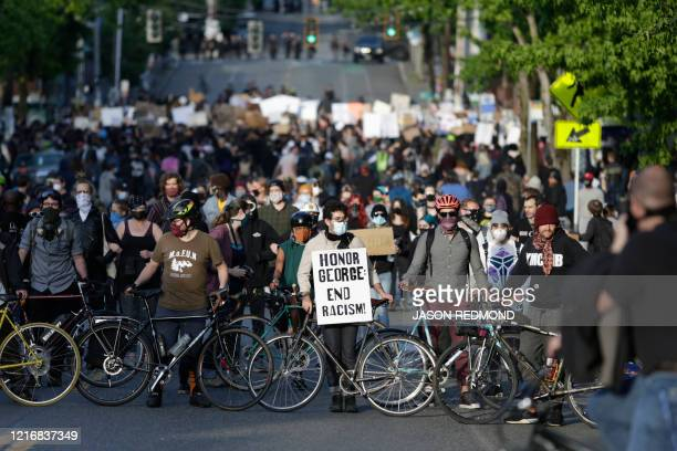 Protesters form a bicycle line as they protest the death of George Floyd in the Capitol Hill neighborhood of Seattle, Washington on June 1, 2020. -...