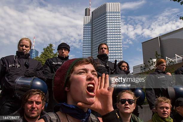 Protesters form a chain as they take part in an unauthorized blockade of a road in front of the EZB building during the Blockupy protests on May 18...