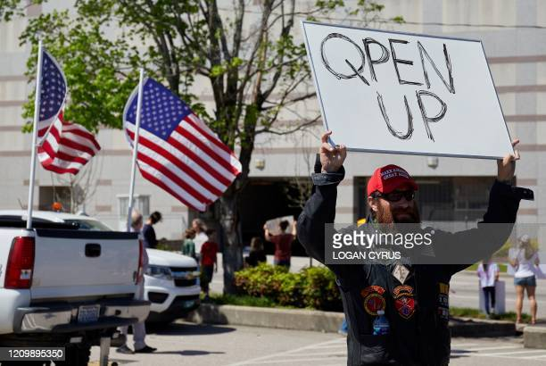 Protesters from a grassroots organization called REOPEN NC demonstrate against the North Carolina coronavirus lockdown at a parking lot adjacent to...