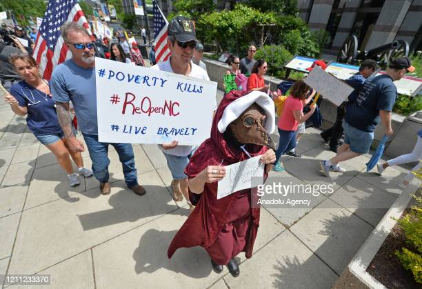 Protesters from a grassroots organization called REOPEN NC gather for pressure North Carolina Governor Roy Cooper to reopen the State in Raleigh, NC,...