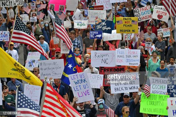 Protesters from a grassroots organization called REOPEN NC gather to pressure North Carolina Governor Roy Cooper to reopen the State in Raleigh, NC,...