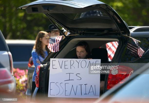 Protesters from a grassroots organization called REOPEN NC protests the North Carolina coronavirus lockdown at a parking lot adjacent to the North...
