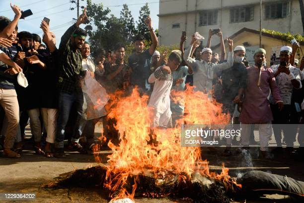 Protesters from an Islamist political party burn an effigy of French president Emmanuel Macron during the demonstration. Protest calling for the...