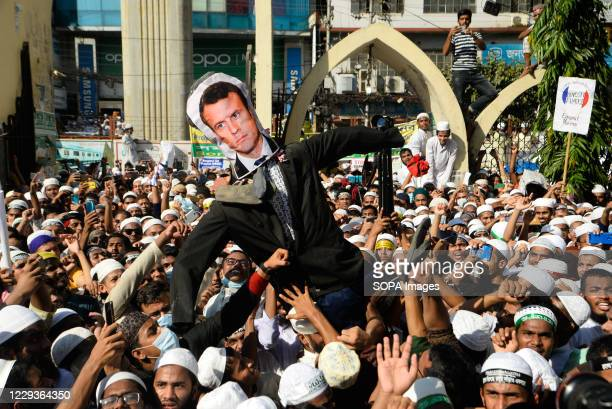 Protesters from an Islamist political party hold an effigy of French president Emmanuel Macron during the demonstration. Protest calling for the...